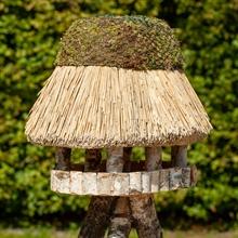 930403-voss-garden-vogelhaus-pellworm-mit-reetdach-oval.jpg