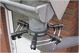 The insulator clamps are attached around the drainpipe.